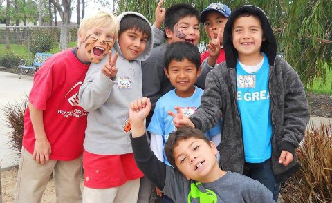 Group of children posing for the camera at the El Toro Park playground area