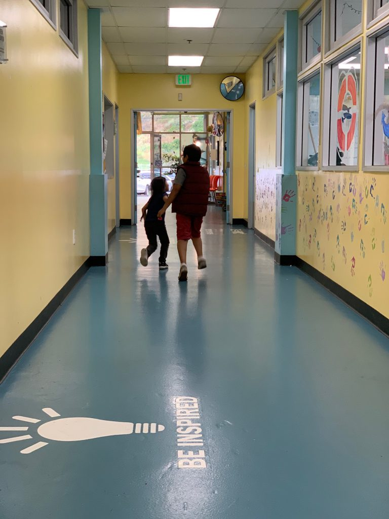 silouette of 2 young children in the hallway of the Canyon Enrichment Center