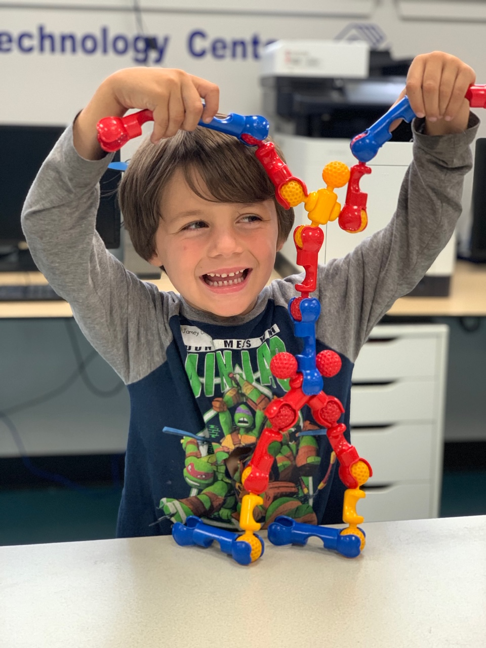 boy playing with snap together toys in Canyon Enrichment Center preschool room