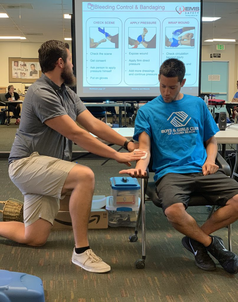 2 young adult men volunteers learning first-aid treatments