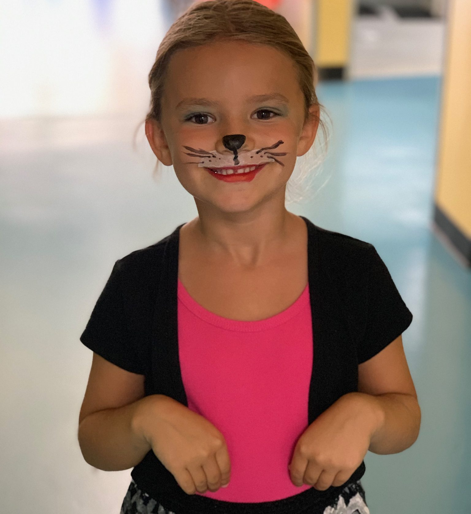 Girl with face paint whiskers