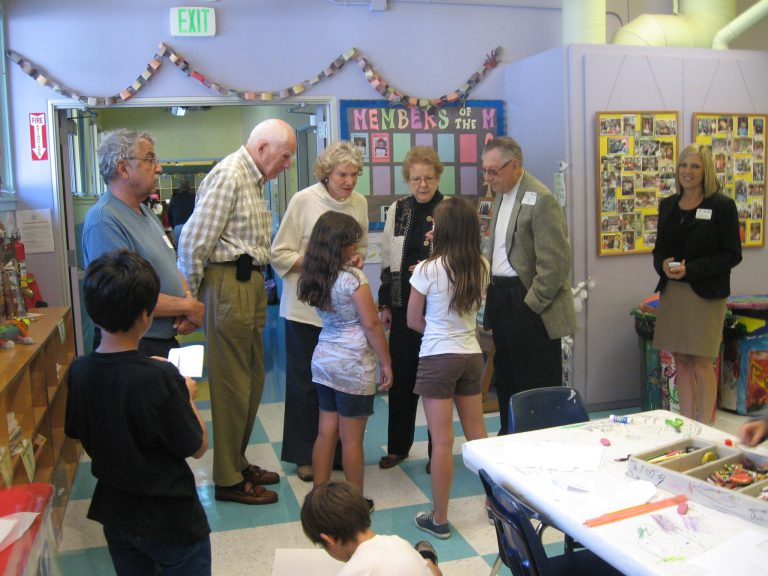 older people talking to kids while taking a tour of the Canyon Enrichment center